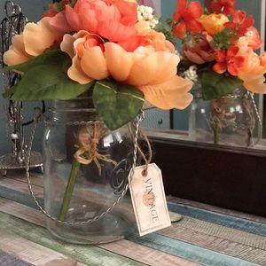 Vintage jar with faux flowers centerpiece